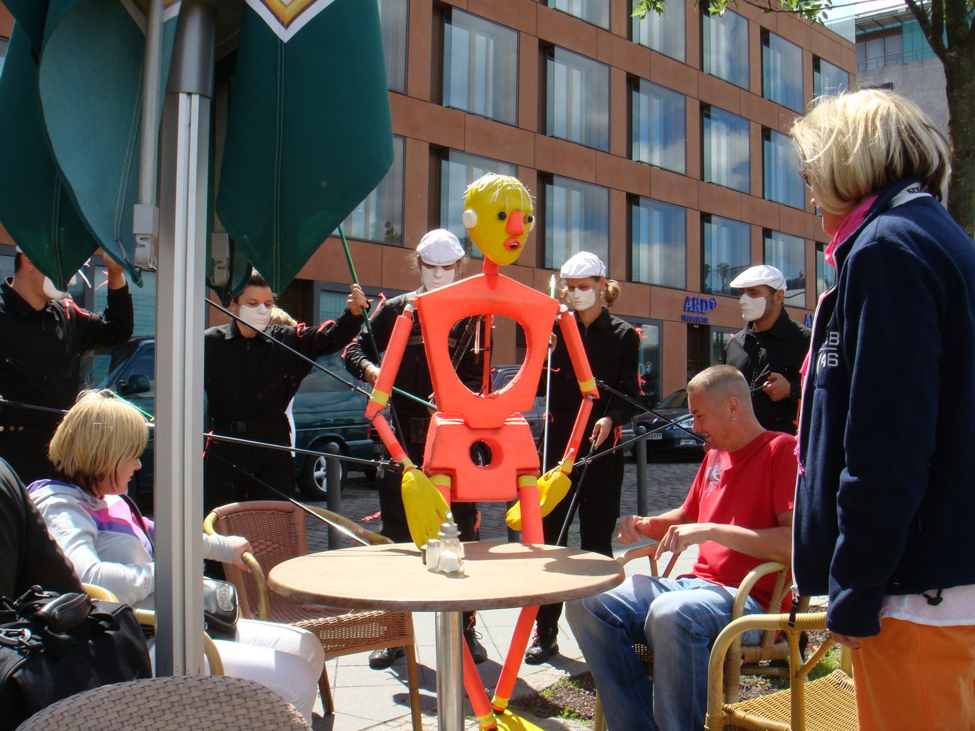 "A group of masked puppeteers controlled ""Orange Man', who was quite friendly and would join you at your table for lunch."