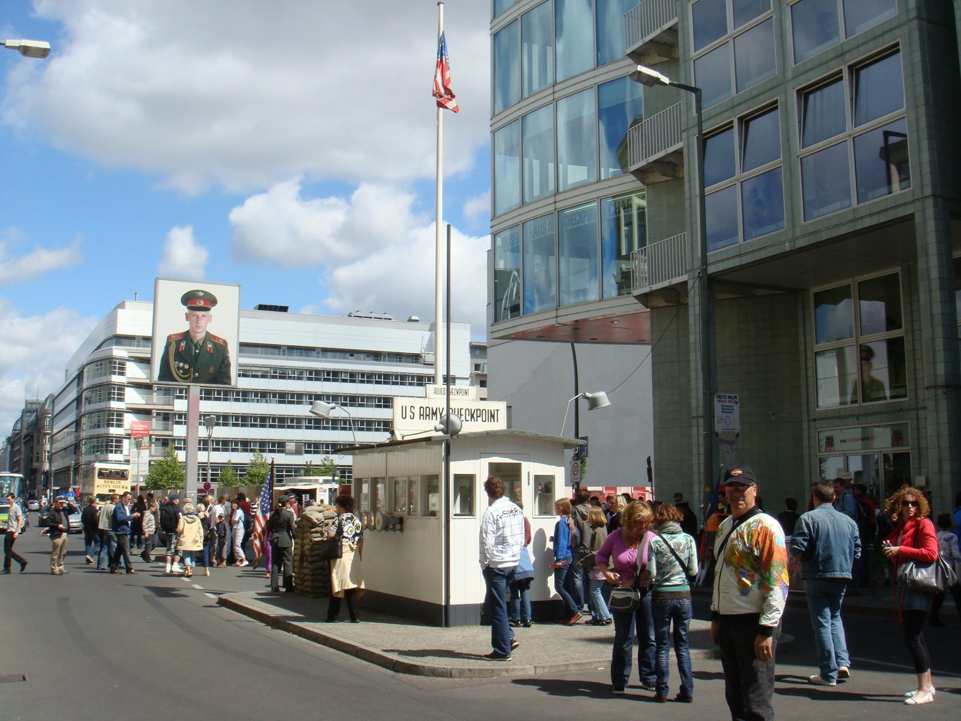 Checkpoint Charlie (and Roger) with the Soviet soldier photo above the street.