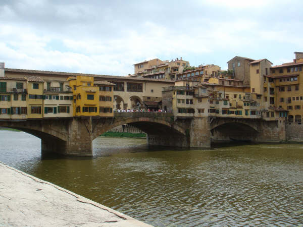 The famously golden Ponte Vecchio over the River Arno in Florence