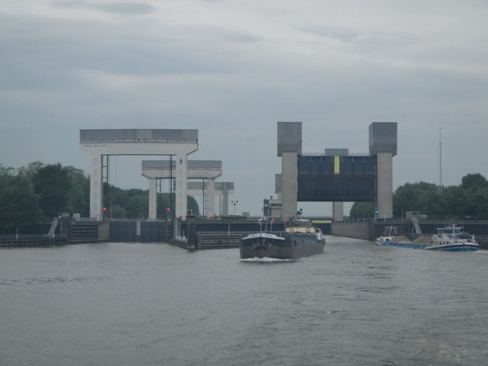 Barges going into guillotine locks near Dusseldorf on a rainy afternoon