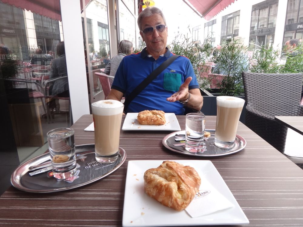 Roger eating Pastry in Vienna